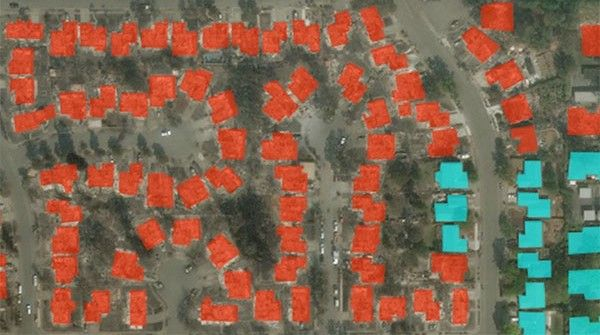 Annotated overhead photograph of buildings damage by fire